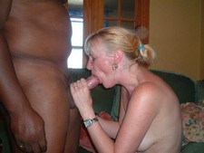 Middle-aged blonde wife sucking hard a huge cock of black swinger friend, wild..