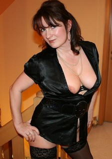 Brunette mature at home.